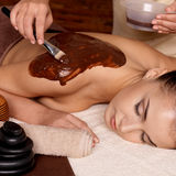 Spa therapy for young woman receiving cosmetic mask Stock Photo