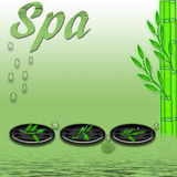 Spa. Three zen stones and bamboo plants on the side peaceful background Royalty Free Stock Image