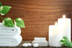 Spa to relax. Towel,candle,pumice,pebble and leaf before wood background Stock Photography