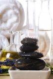Spa tools. Bowl of hot stones for lastone massage stock photos