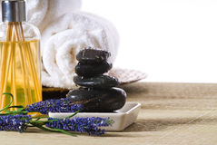 Spa tools. Massage stones and towels spa tools and oil stock photos