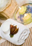 Spa towel. A white spa towel with and some candles floating on water in a glass bowl Stock Photos