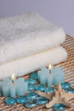 Spa towel and candles Royalty Free Stock Photography