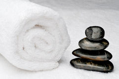 Spa towel with dark spa stones Stock Photography
