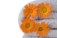 Spa towel and orange flower Stock Images