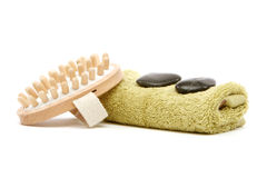 Spa towel, rocks and massager. Spa towel, black river rocks and wooden massager isolated on white background Royalty Free Stock Photo