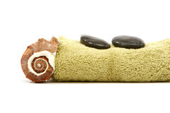 Spa towel, rocks and seashell Royalty Free Stock Photo