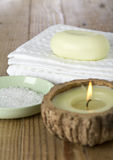 Spa towel soap and bath saltd. Close up of day spa items including soap, towel, candle and bath salts Stock Photos