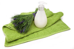 Spa towel, soap and bunch of herbs isolated Royalty Free Stock Photo