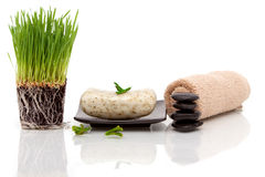 Spa towel, soap and wheatgrass Royalty Free Stock Photo