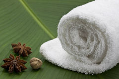 Spa, towel, star anis. Face towel on a banana leaf Royalty Free Stock Image