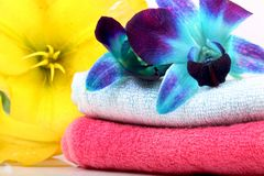 Spa towels. Beautiful shot of spa towels with flowers royalty free stock photos
