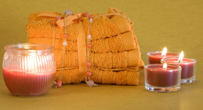 Spa towels and candles Stock Images