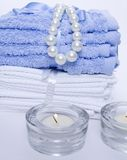 Spa towels and candles Royalty Free Stock Images