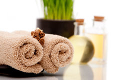 Spa towels, cinnamon sticks and essential body oil Stock Photo