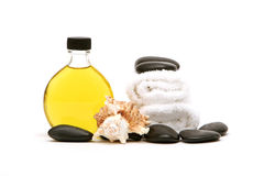 Spa towels, oil and rocks Stock Photography
