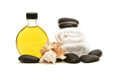 Spa towels, oil and rocks royalty free stock photography