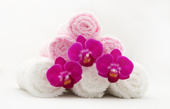 Spa towels and orchids. Close-up of spa towels and orchids on white background Royalty Free Stock Photography