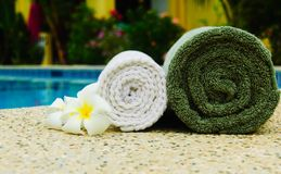 Spa towels. With plumeria flower near the pool Stock Image