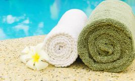 Spa towels. With plumeria flower near the pool Stock Images