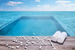 Spa and towels by the pool Stock Images