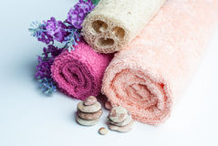 Spa towels rolls, flower and stones. Royalty Free Stock Photography