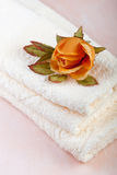 Spa towels with rose Royalty Free Stock Photos