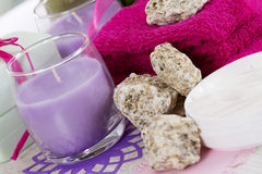 Spa towels, soap and candles Stock Images
