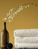 Spa Towels, Vase and Flowers Royalty Free Stock Image