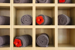 Spa towels in wooden rack. Royalty Free Stock Photo
