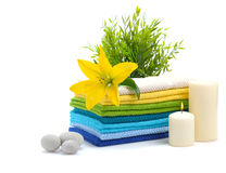 Spa towels with yellow lily Stock Photography