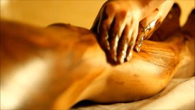 The spa tratment with scrub with coffee and chocolate on the body parts