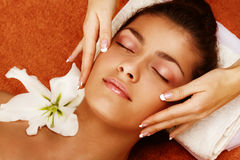Spa treatment. Portrait of young woman getting a spa treatment royalty free stock image