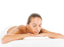Spa treatment. Young woman is on spa treatment, isolated on white Stock Image