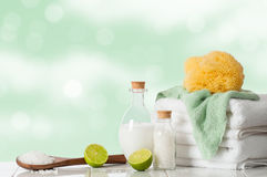 Spa Treatment. With lime and salts with towels and sponge Royalty Free Stock Photos