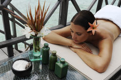 Spa treatment. Beautiful woman getting spa treatment at daylight near the ocean stock photography