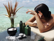 Spa treatment. Beautiful woman getting spa treatment at daylight near the ocean Royalty Free Stock Photo