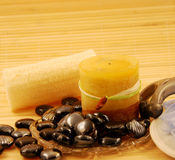 Spa treatment. Spa home treatment, consisting of loofas, candles, decorative smooth stones Royalty Free Stock Photography