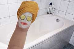Spa Treatment. Beautiful Woman Illustrated as a Finger having a Spa Treatment Stock Image
