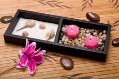 Spa treatment. With flowers, candles and stones Royalty Free Stock Photos