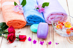Spa treatment. Spa accessories with roses and flower petals Stock Image