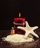 Spa Treatment Aromatherapy. Mineral salts in a tranquil spa setting with candle for aromatherapy Stock Photos