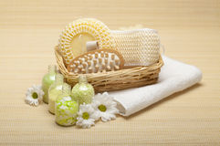 Spa treatment - bath salt and massage tools. Spa treatment - green bath salt and massage tools stock image
