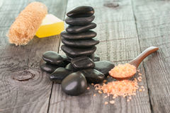 Spa treatment with bath salt and zen stones Stock Photography