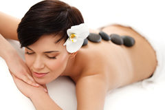 Spa Treatment. Beautiful Woman Getting Stones Massage Royalty Free Stock Photo