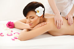 Spa Treatment. Beautiful Woman Getting Stones Massage in Spa Sal Royalty Free Stock Photography