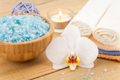 Spa Treatment with candle and blue sea salt Royalty Free Stock Photography