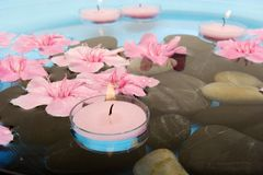 Spa treatment with candles Stock Photos