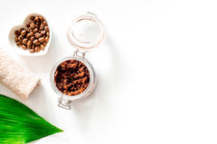 Spa treatment. Coffee scrub on white background top view copyspace Stock Photo
