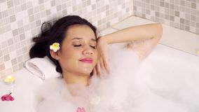Attractive woman relaxing in bathtub stock video